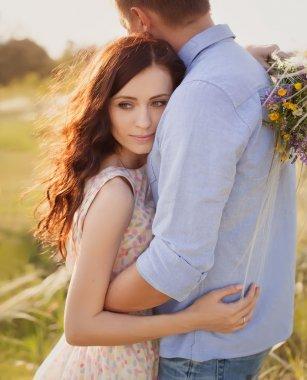 beautiful brunette woman in love hugging her boyfriend