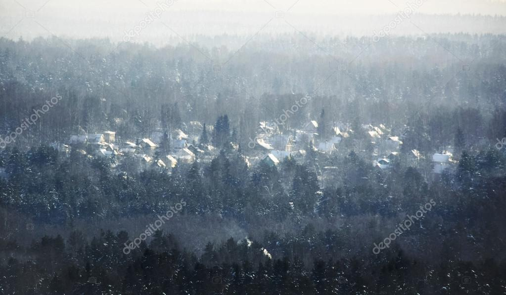 Village cottages, rustic homes in winter time covered with snow