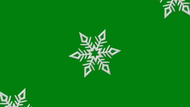 Szilveszter video képernyő megtakarító fehér stilizált hópelyhek szórnak a központból különböző irányokba, zöld alapon