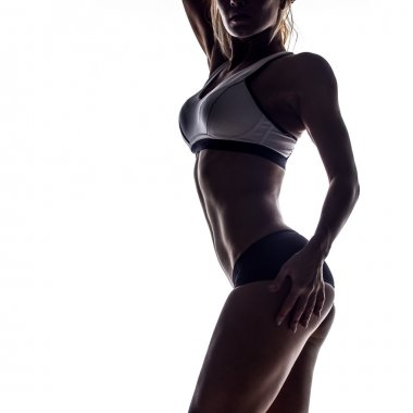 silhouette of young fitness woman