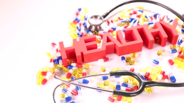 Health sign with stethoscope and pills