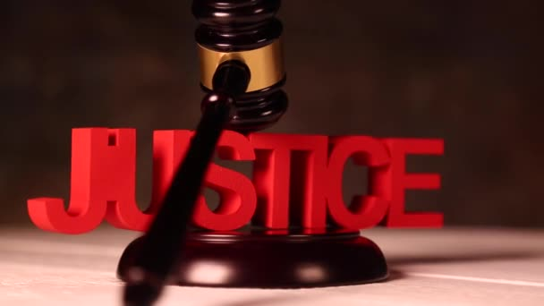 Wooden gavel with justice sign
