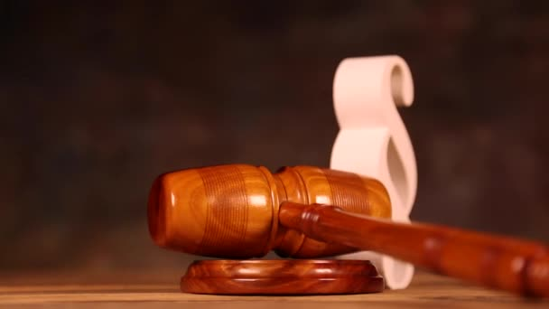 Paragraph sign with wooden gavel