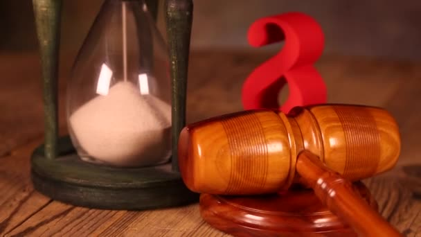 Hourglass, wooden gavel with paragraph sign