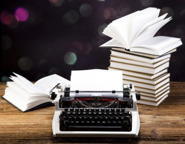 Retro typewriter with books