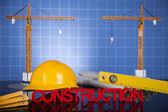 Fotografia edifici in costruzione e gru