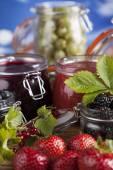 Photo Homemade fruit jam in the glass jars