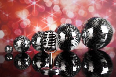 retro style microphone and disco balls