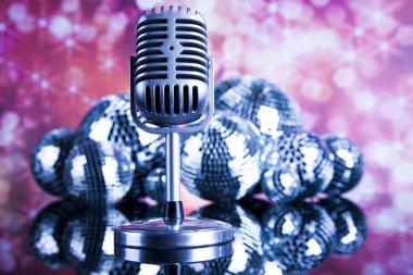 retro style microphone and disco balls
