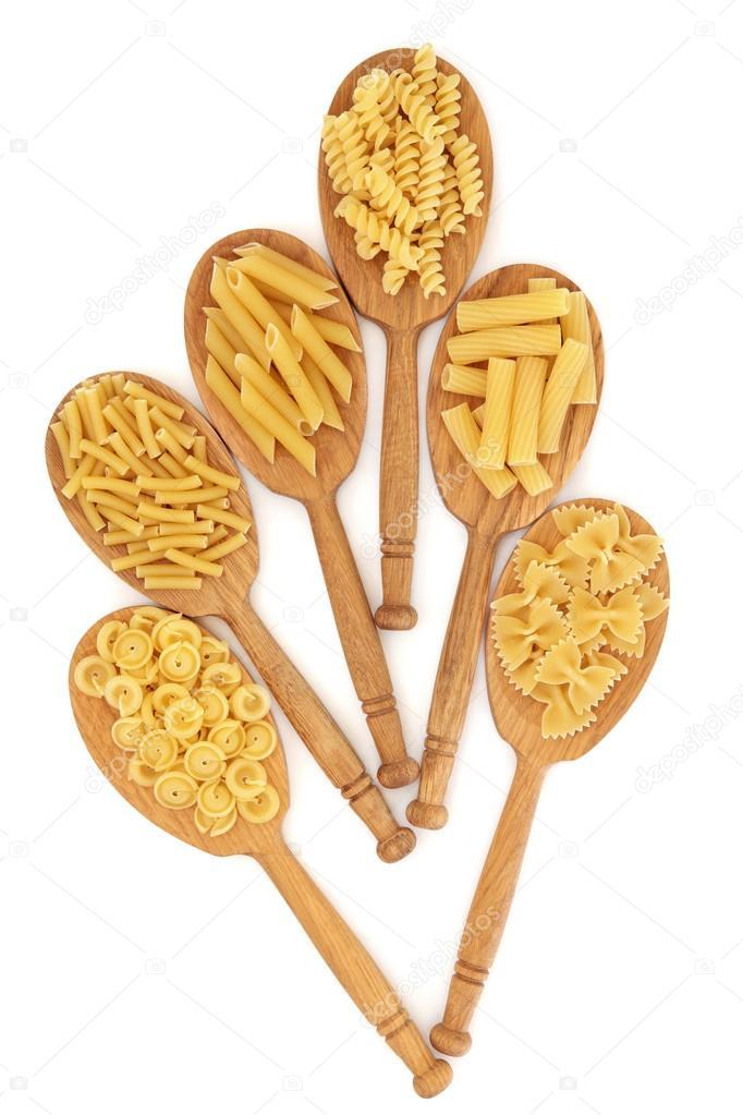 Pasta in Oak Spoons — Stock Photo © marilyna #64268875