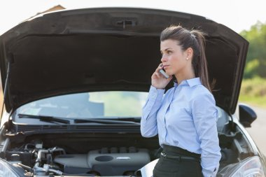 Businesswoman is calling assistance for car problems