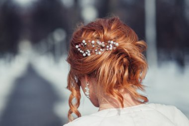 Wedding hairstyle of the bride, the beautiful decorations of the
