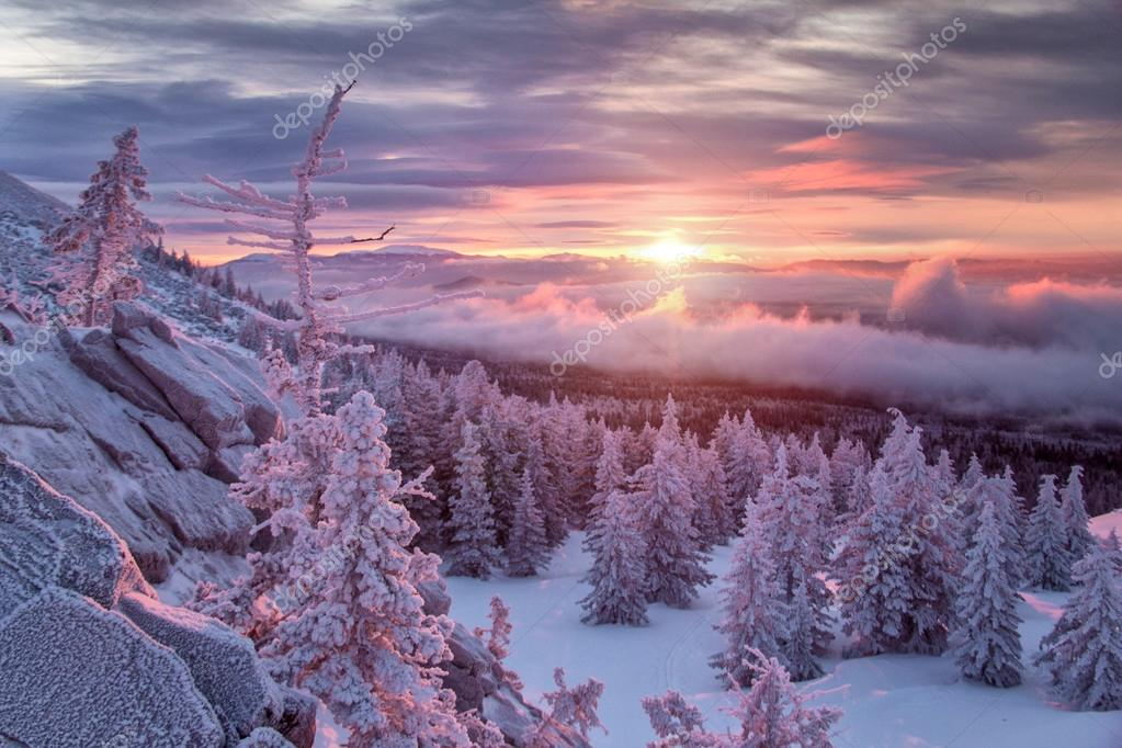 Winter landscape in mountains at sunrise