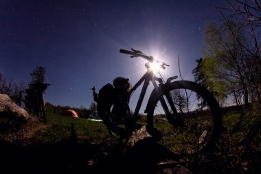 silhouette of mountain bike at night