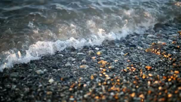 pebble beach with wave closeup.