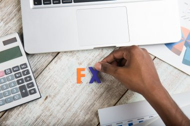 fx word with hand and laptop