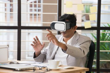 Indian man with virtual reality technology