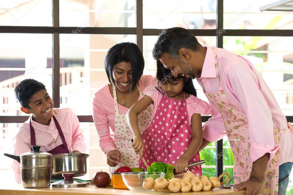 Indian Family Cooking At Home Stock Photo C Yuliang11 123454632