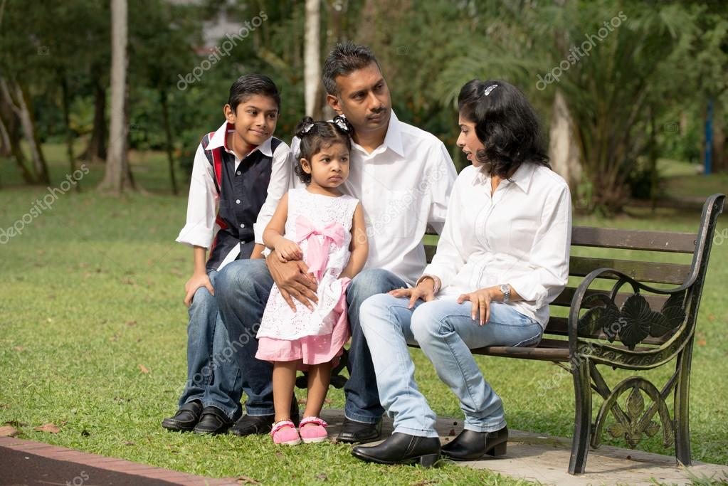 Indian family sitting on bench