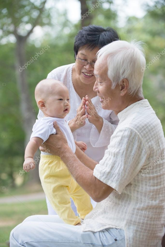 Grandparents playing with baby grandson