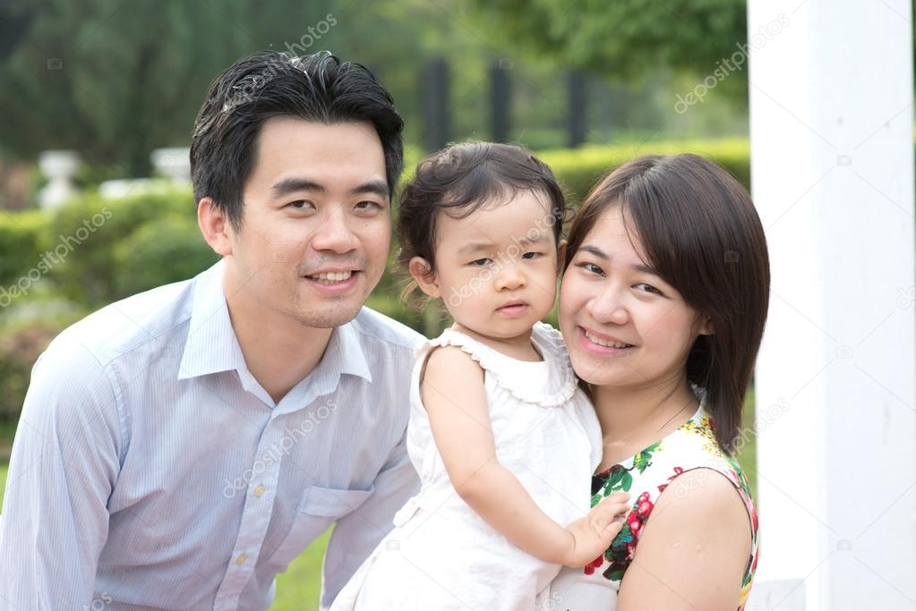 Happy Asian Family  in park