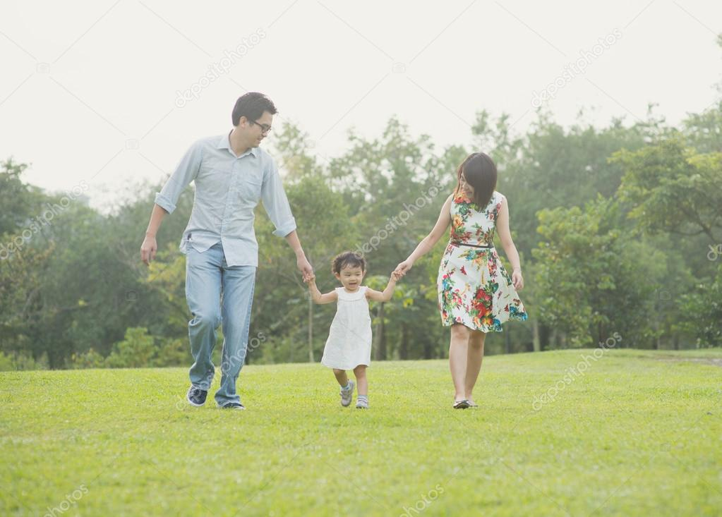 Happy Asian Family  together in the park