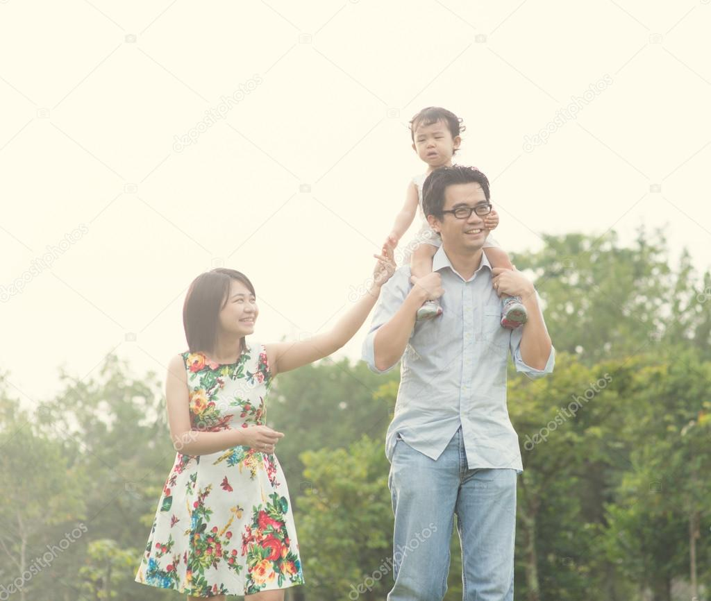 Asian family playing and enjoying