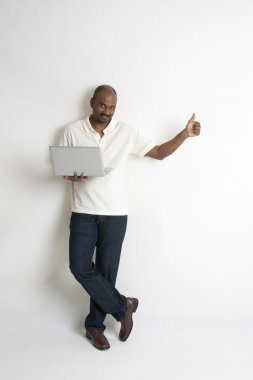 Casual indian male with a laptop