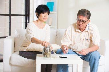Asian senior couple calculating finance