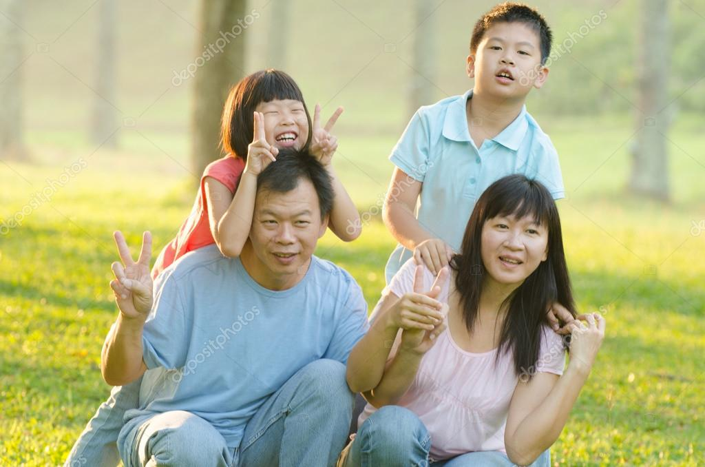Family  playful and smiling in park