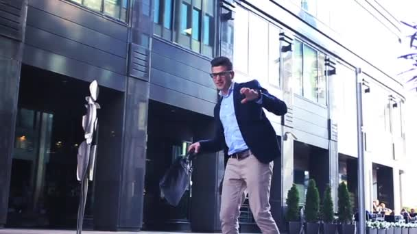 Businessman dancing Contemporary happy funky caucasian street dancer freestyle in the city
