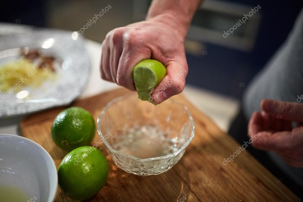 chef squeezing lime in a bowl — Stock Photo © Xalanx #102887534