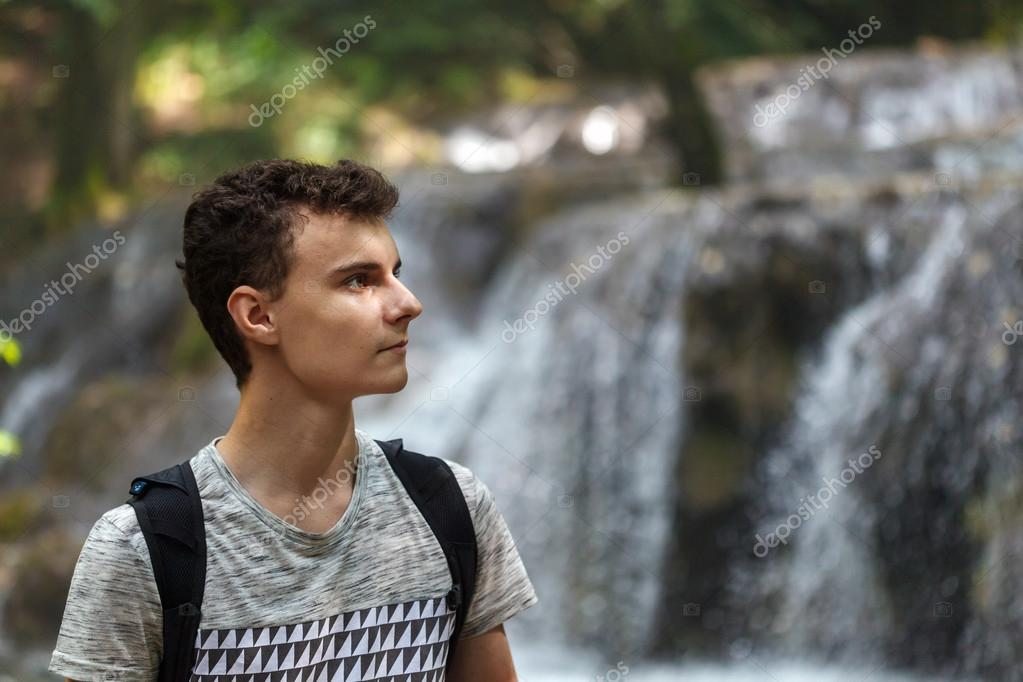 hiker with backpack near a waterfall