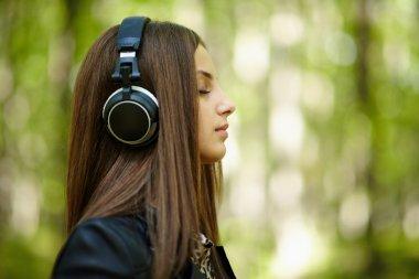 Girl listening music outdoor