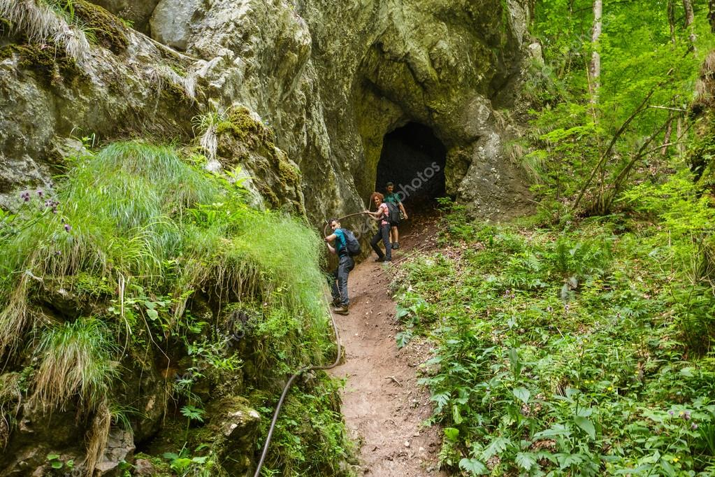 hikers getting out from a cave