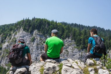 male hikers sitting