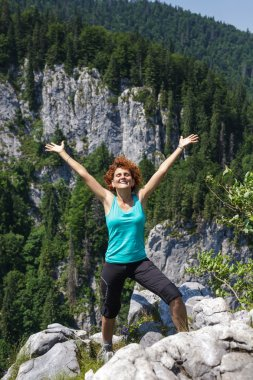 woman hiker celebrating freedom