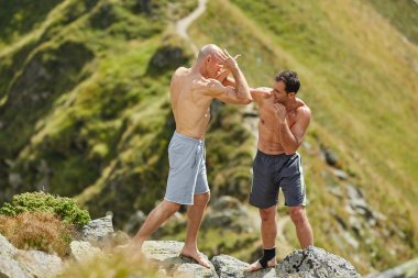 fighters sparring in the mountains