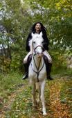 Fotografie Frau auf einem Pferd