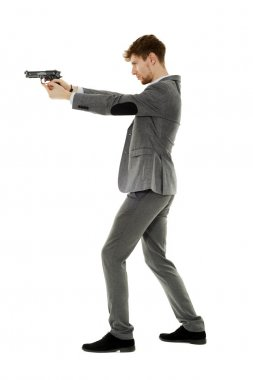 Handsome young man aiming the gun to an invisible target stock vector