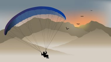 Para-glider hovers over the mountain