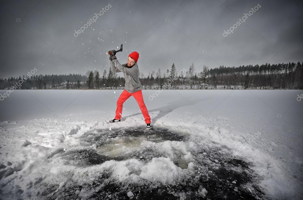 Bearded man chops ice