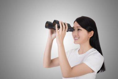 Woman using binoculars, studio shot portrait stock vector