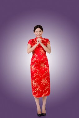Chinese woman in traditional cheongsam in the new year stock vector