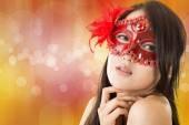 gyönyörű nő egy karneváli maszk