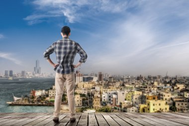 Asian man standing and looking the skyline of the city, Kaohsiung, Taiwan, Asia. stock vector