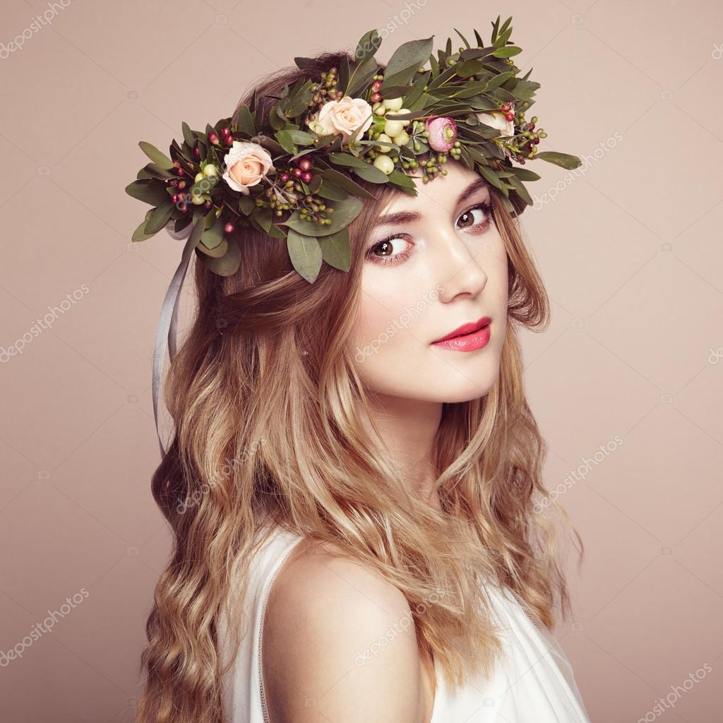 Beautiful blonde woman with flower wreath stock photo beautiful blonde woman with flower wreath on her head beauty girl with flowers hairstyle perfect makeup beauty fashion izmirmasajfo