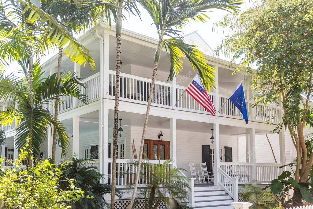 American Flag On White Wood House With Two Verandas In Key West U2014 Photo By  Dbvirago