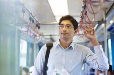 Indian business man inside train.