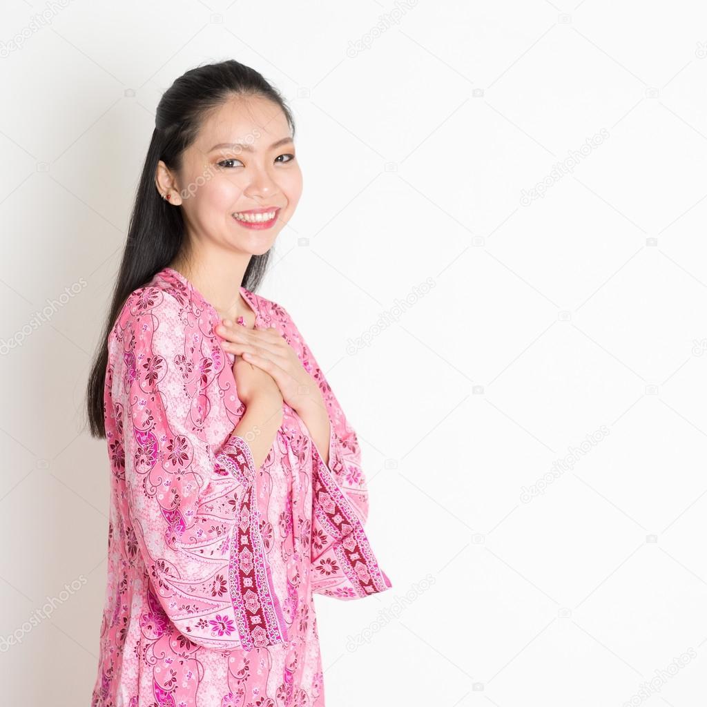 Asian female in pink batik dress
